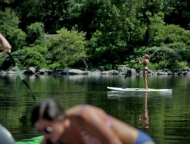 girl doing stand up paddling