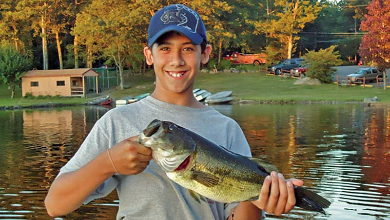 otter-lake-camp-resort-boy-with-fish