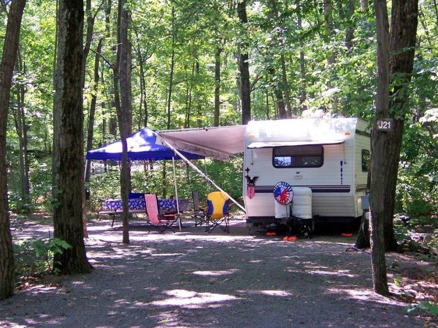 otter lake resort camper on wooded site