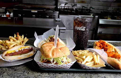 paulies-hot-dogs-honesdale-lineup-of-sandwiches-and-fries-with-coca-cola