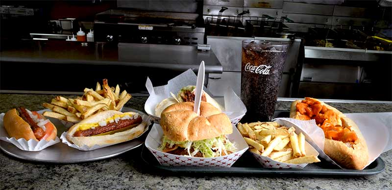 paulie's-hot-dogs-honesdale-lineup-of-sandwiches-and-fries-with-coca-cola