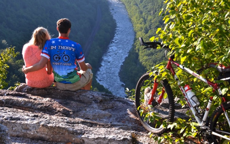 couple with bike overlooking the river