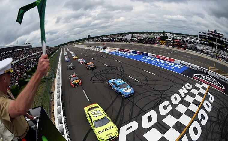 pocono raceway cars at the finish line