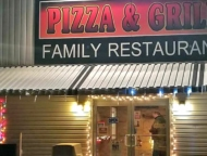 rolly's pizza and grill front of building