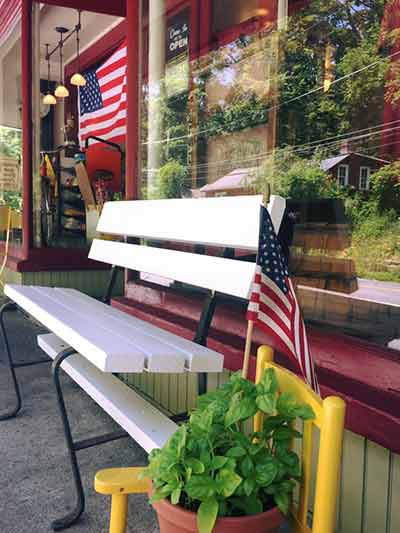 shawnee-general-store-since-1859-bench-and-flowers