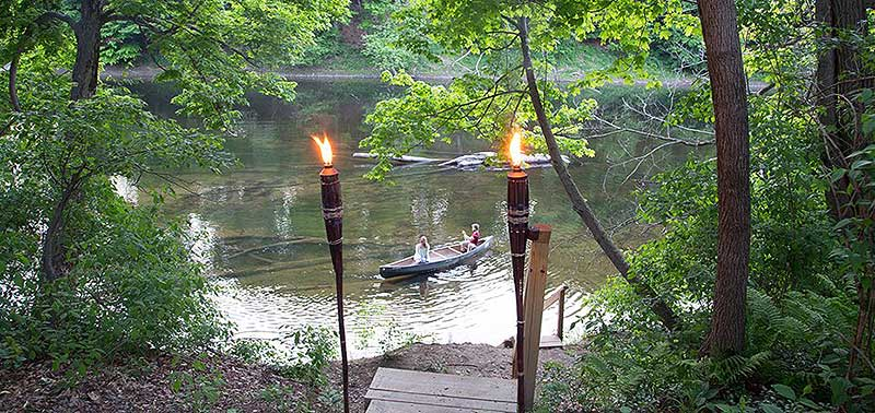 shawnee-river-trips-canoe-near-shore and tiki torches