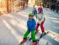 3 kids skiing down hill