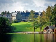 main lodge, lawn, lake, and boathouse