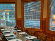 dining tables along double windows