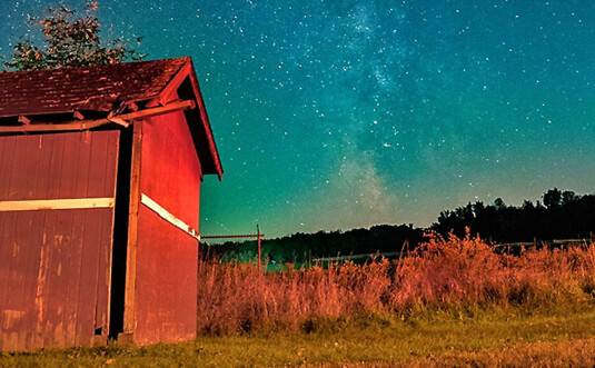 shed on farm property at night