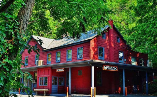 the-minisink-hotel-exterior-in-trees