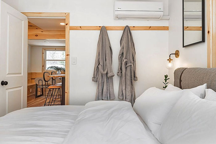 guest room with bed and bathrobes