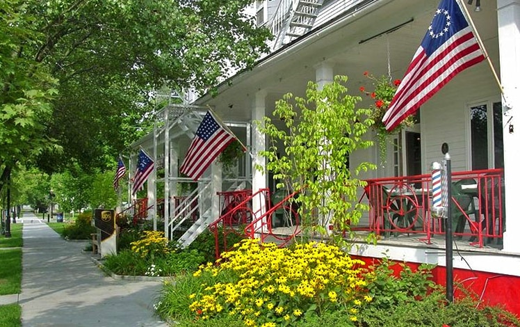 front porch and treed sidewalk