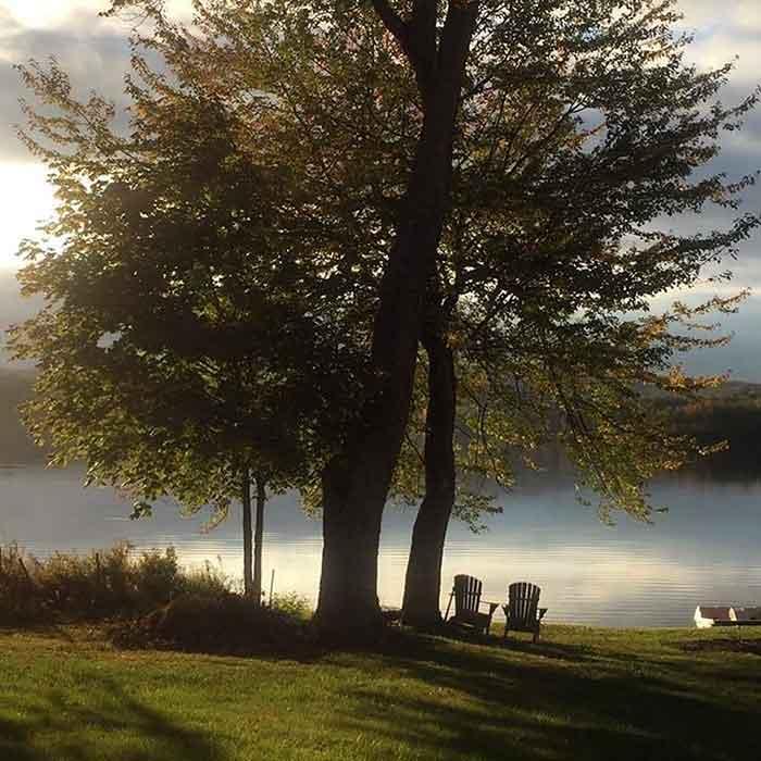 tuscarora-lodge-adirondack-chairs-on-beach-lake-like a painting