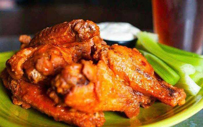 plate of chicken wings and beer